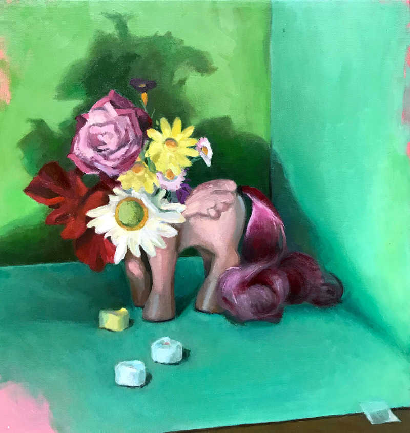 Square contemporary oil painting by Philadelphia, PA artist Elizabeth Virginia Levesque. Still life painting featuring a vintage My Little Pony pink body. Instead of the pony doll's head is a colorful bunch of flowers sitting in the neck hole like the pony doll is a vase. Conversation candy hearts lay in the foreground. The composition's background is made up of green and teal blue paper.