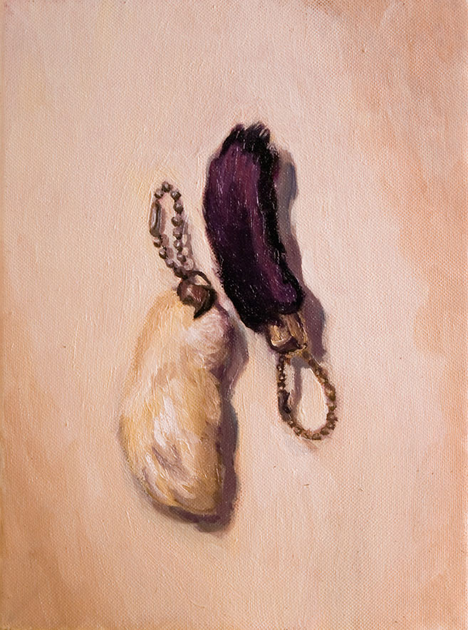 Double the Luck is a small still life painting by Philadelphia artist Elizabeth Virginia Levesque. Two rabbit's feet lay on a flat, white surface. One is white furred, the other is purple. Both have brass chain.